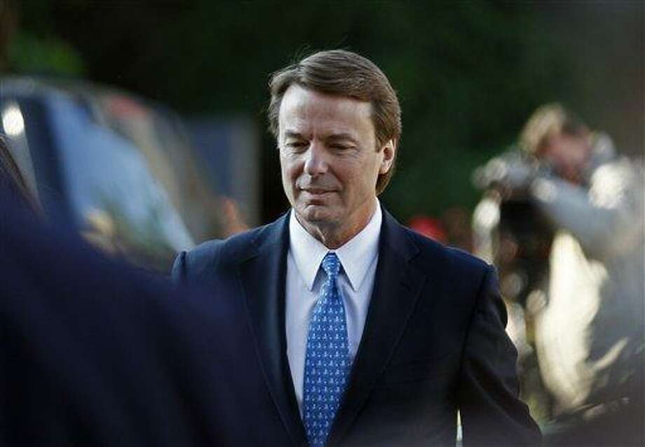 Former U.S. Sen. and presidential candidate John Edwards arrives at federal court in Greensboro, N.C., recently. Prosecutors and defense lawyers will begin making their case to jurors on whether the former presidential candidate violated federal campaign finance laws.  Associated Press Photo: ASSOCIATED PRESS / AP2012