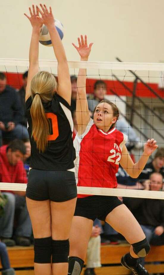 Dispatch Staff Photo by JOHN HAEGER (Twitter: @OneidaPhoto) VVS' Emily Brown (22) has her shot blocked by RFA's Allaina Johnson (10) in the first game of the match on Wednesday at VVS. The Red Devils won the match 3-0.