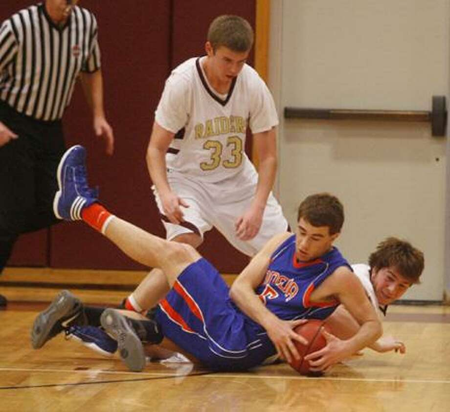 Dispatch Staff Photo by JOHN HAEGER (Twitter: @OneidaPhoto) Canastota's Nicholas Stagnitti (33) and Matt Rusittano (30) battle with Oneida's Kyle Peck (5) for a loose ball during a game last year. All three players return to their teams for the 2012-13 season.