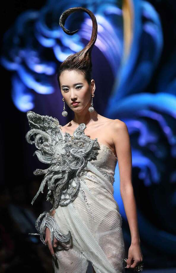 A model showcases a creation by Chinese designer Guo Pei on Tuesday Nov. 27, 2012,  in Singapore during the Asian Couture 2012 Singapore fashion show. (AP Photo/Wong Maye-E) Photo: ASSOCIATED PRESS / AP2012