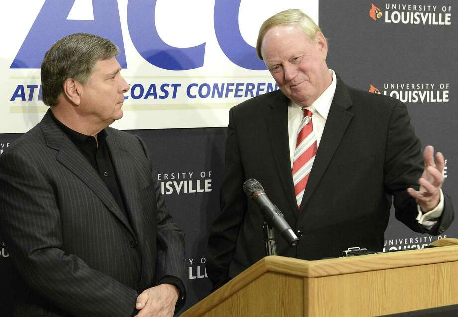 University of Louisville President Dr. James Ramsay, right, and Louisville Athletic Director Tom Jurich field questions during a news conference, Wednesday, Nov. 28, 2012, in Louisville, Ky., announcing that the university is joining the Atlantic Coast Conference Photo: ASSOCIATED PRESS / Timothy D. Easley2012