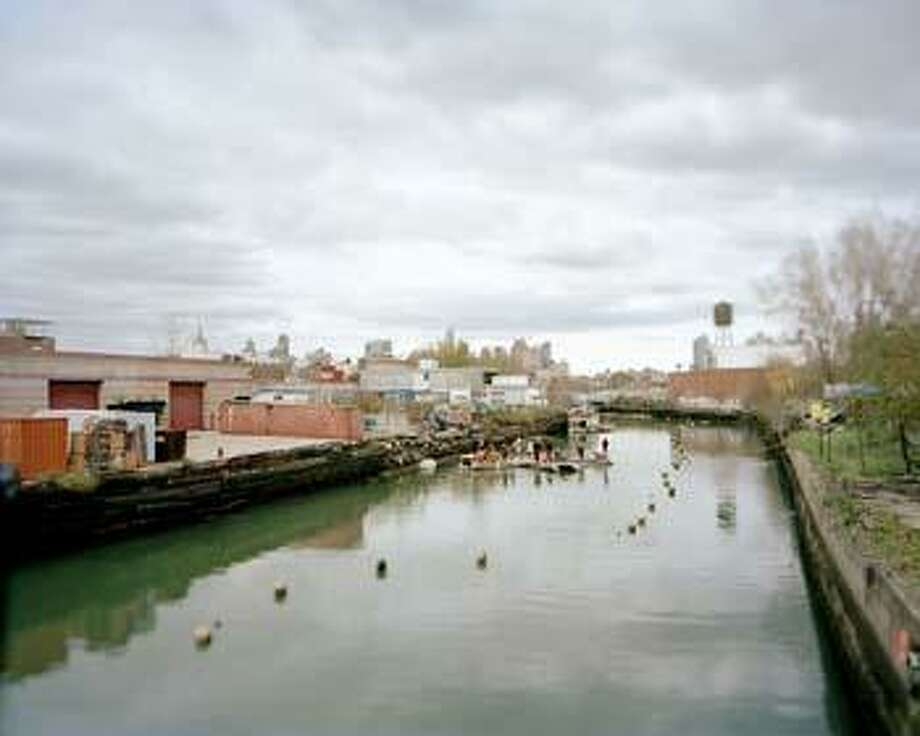 A photograph of the Gowanus Canal by Brooker Singer; part of an exhibit of her photographs of Superfund sites at The Tremaine Gallery at The Hotchkiss School in Salisbury.