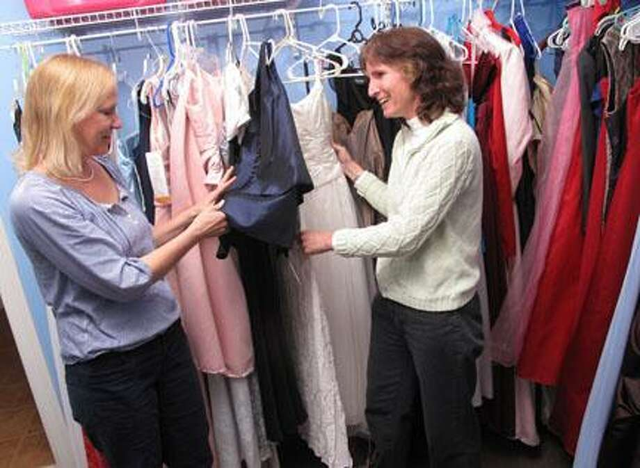 Dispatch Staff Photo by JOHN HAEGER (Twitter.com/OneidaPhoto)Patty Hodge and Susan Nolen sort dresses at Cinderella's Closet on Thursday, March 29, 2012 in Hamilton. A fashion show will be held on Saturday, March 31, 2012 at Donovan's Pub at Colgate University to showcase the dresses.