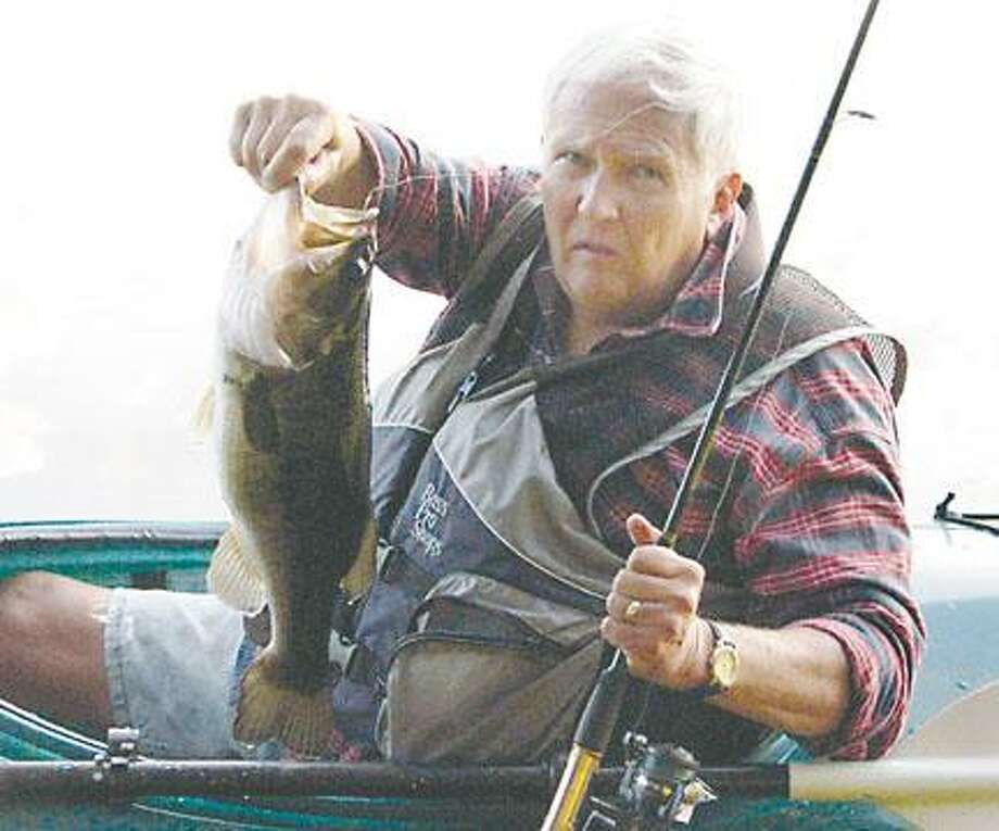 Photo Courtesy Leo MaloneyNoted outdoors Columnist Leo Maloney shows a largemouth bass he caught from a kayak in a small lake in the Adirondacks.