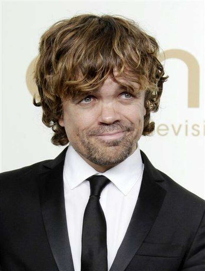 "In this file photo, Peter Dinklage from the HBO series ""Game of Thrones"" poses backstage at the 63rd Primetime Emmy Awards in Los Angeles.  Dinklage won the Emmy for best supporting actor in a drama series for his role as Tyrion Lannister. Dinklage, 43, who has been a vegetarian since he was 16, is the national spokesman for Farm Sanctuary's annual Walk for Farm Animals. He has filmed a YouTube video and will spend his off season promoting the group's campaign to change the way society views and treats farm animals. (AP) Photo: AP / AP2011"