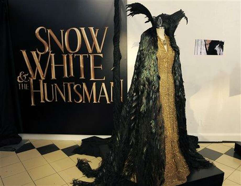 "This photo shows a costume from the film ""Snow White and the Huntsman"" in Los Angeles. The costume, designed by Academy Award-winning costume designer Colleen Atwood, was worn by actress Charlize Theron in the film. (AP) Photo: AP / AP2012"