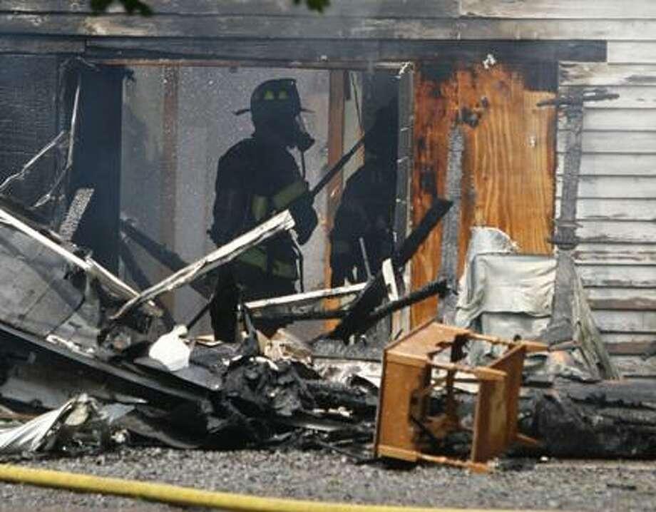 Dispatch Staff Photo by JOHN HAEGER (Twitter.com/OneidaPhoto)Fire crews battle a structure fire in Durhamville on Tuesday, May 29, 2012.