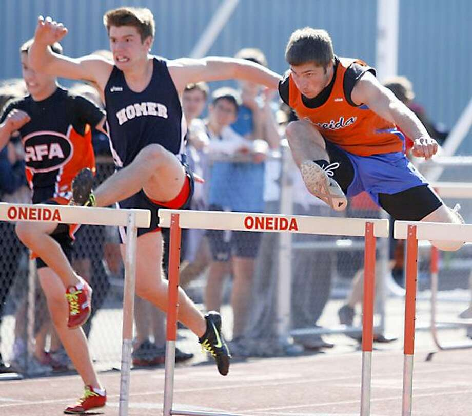 """Dispatch Staff Photo by JOHN HAEGER <a href=""""http://twitter.com/oneidaphoto"""">twitter.com/oneidaphoto</a> Oneida's Jimmy Moyer, right, pulls ahead of the field during the 100 meter hurdles heat on Friday, May 10, 2012 at the Oneida Invitional. Moyer advanced to the finals where he placed."""