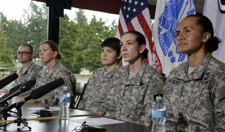 U.S. Army soldiers, from left, Staff Sgt. Brian Hall, 1st Sgt. Marcia McGee, Spc. Vanessa Davila, Spc. Heidi Olson, and Maj. Sheila Medeiros talk to reporters, Thursday, Jan. 24, 2013, at Joint Base Lewis McChord, Wash. about the decision announced by defense leaders Thursday to open a quarter-million combat and other military positions to service members regardless of gender. (AP Photo/Ted S. Warren) Photo: ASSOCIATED PRESS / AP2013