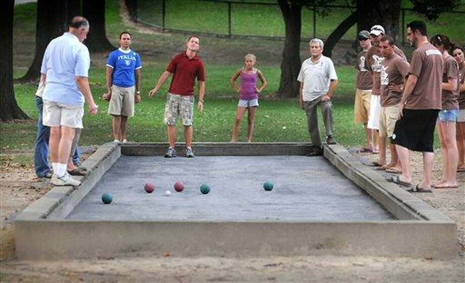 Register sports columnist Chip Malafronte feels that because backyard barbecue games like ping pong, badminton and jumping on a trampoline are Olympic sports, why not bocce? Chip's fingers are crossed for 2016. (Associated Press file photo) Photo: ASSOCIATED PRESS / AP2010