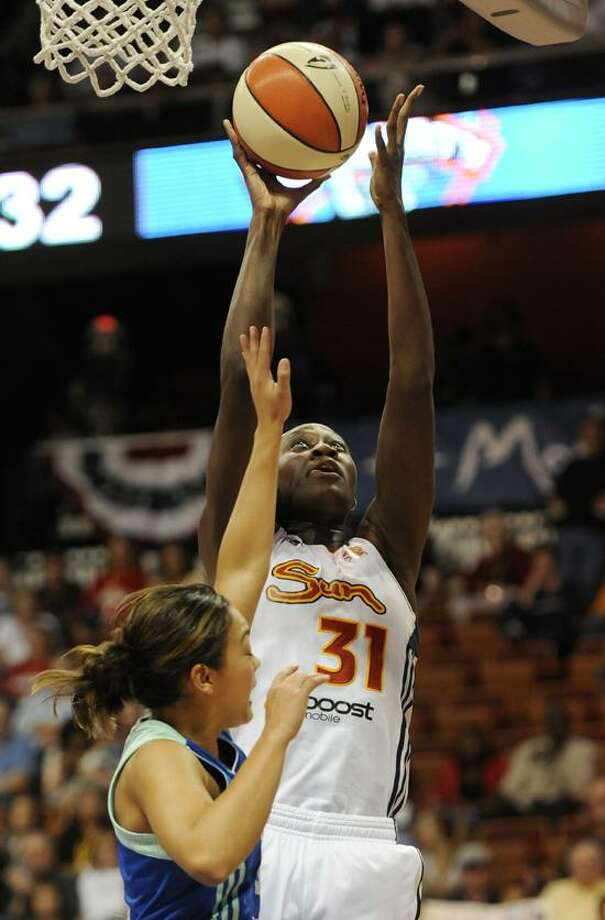 Connecticut Sun's Tina Charles (31) goes up for a basket while guarded by New York Liberty's Leilani Mitchell during the first half of Game 1 of an opening-round WNBA basketball playoff series in Uncasville, Conn., Thursday, Sept. 27, 2012. (AP Photo/Jessica Hill) Photo: AP / FR125654 AP