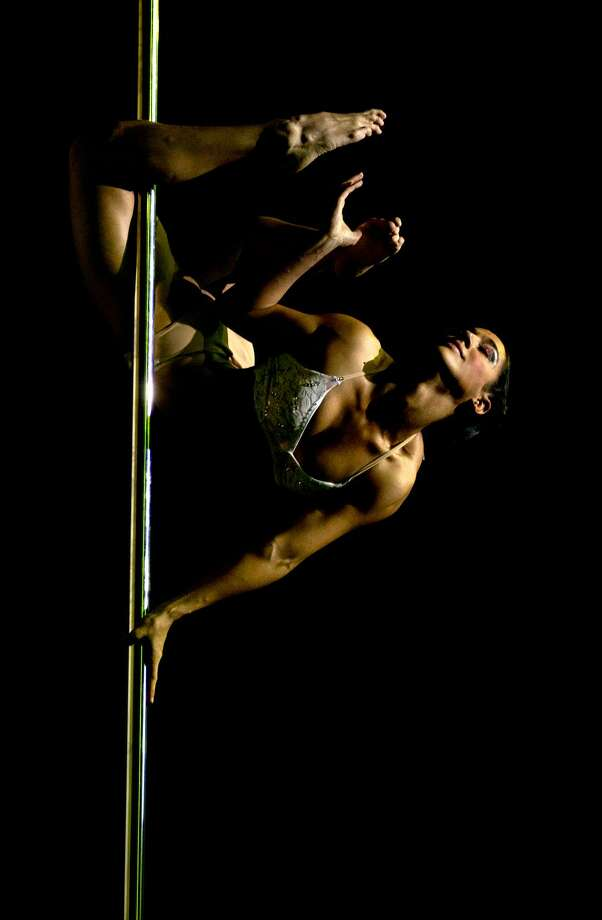 Pole dancer Micaela Garcia, of Argentina, performs her routine during the Miss Pole Dance South America 2012 and Pole Dance Argentina 2012 competitions in Buenos Aires, Argentina, Monday, Nov. 26, 2012. (AP Photo/Natacha Pisarenko) Photo: ASSOCIATED PRESS / AP2012