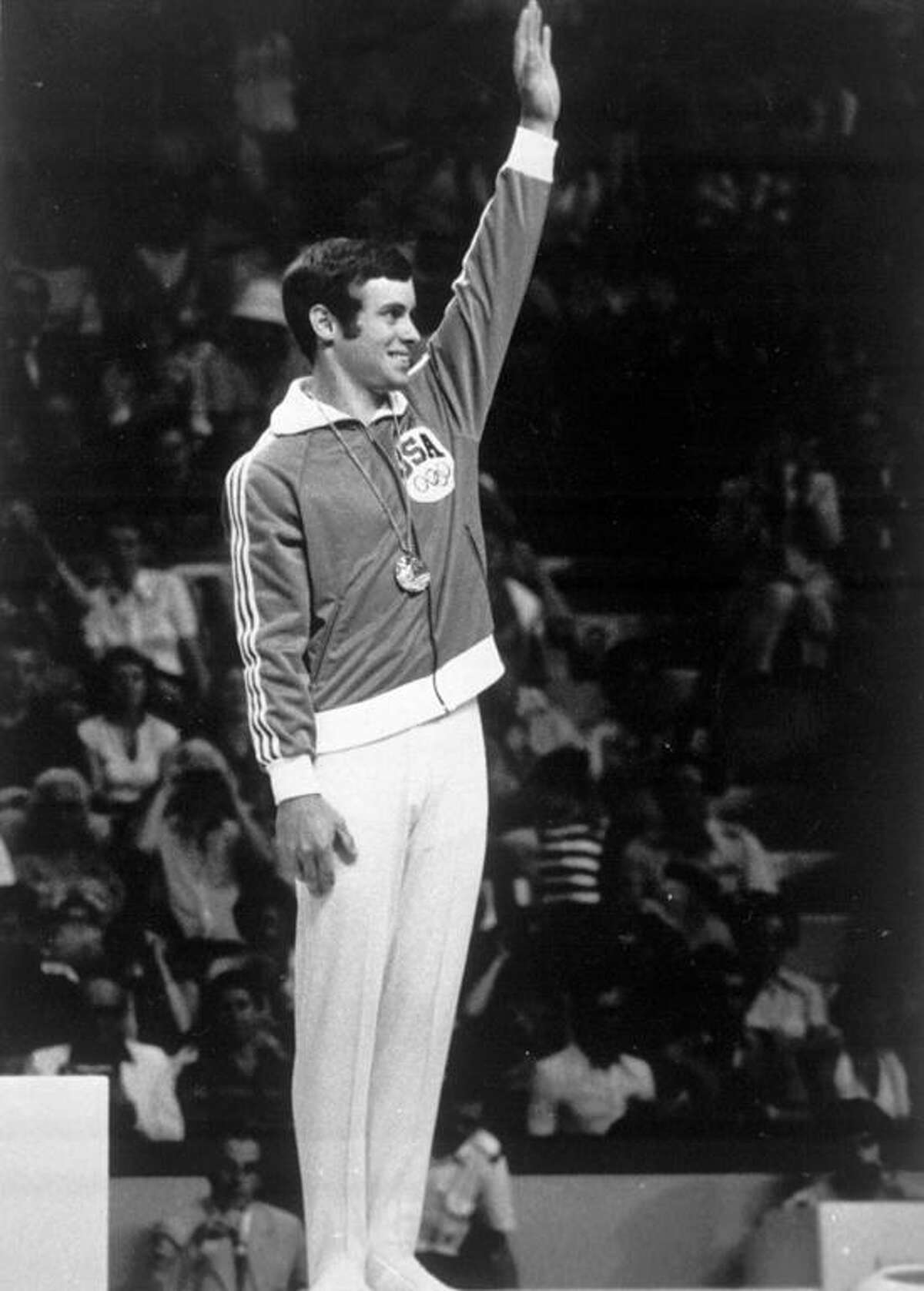 Peter Kormann acknowledges the applause of the crowd after being awarded the bronze medal in the men's floor exercise in this 1976 file photo. (AP Photo/File)