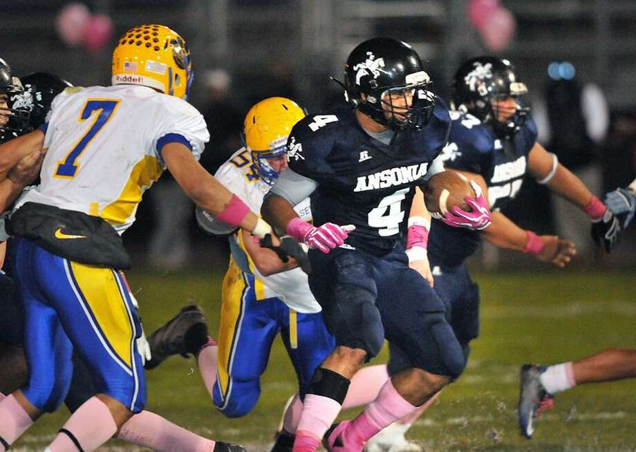 Ansonia's Andrew Matos looks for room to run against Seymour earlier this year. (Photo by Peter Casolino/New Haven Register)