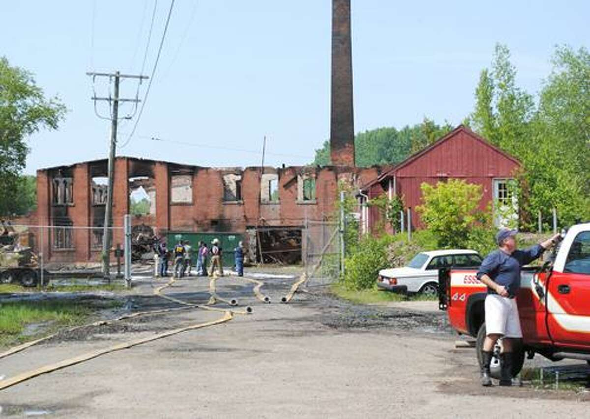 Viktoria Sundqvist I The Middletown PressHealth officials walk the scene of the fire at the Bevin Bell Factory in East Hampton on Sunday afternoon after a fire destroyed the building overnight.