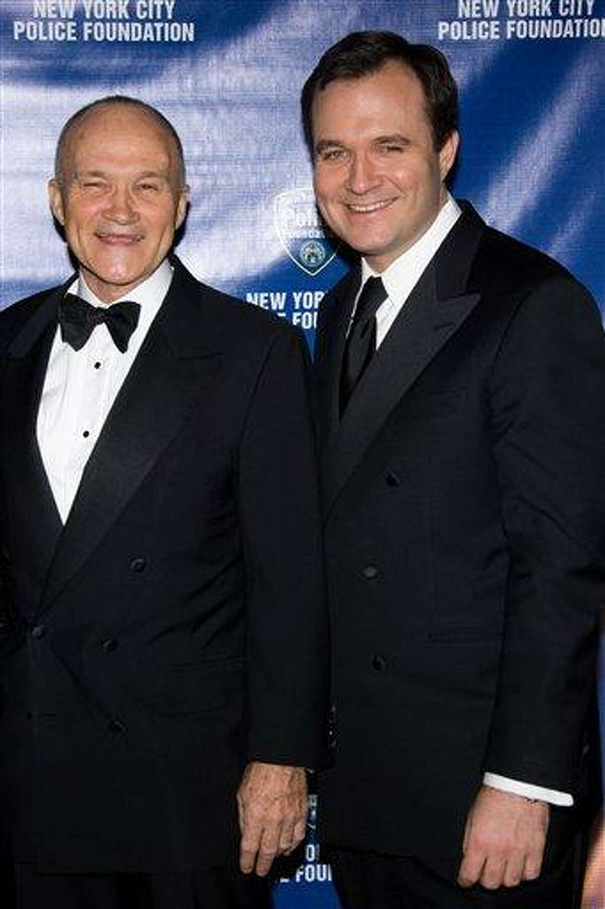 New York Police Commissioner Raymond Kelly and son Greg attend the New York City Police Foundations 31st Annual Gala in New York, in this March 3, 2009 file photo. Kelly, son of the city police commissioner, is under investigation by prosecutors and denies any wrongdoing, his lawyer said Wednesday without elaborating on the allegations. Associated Press