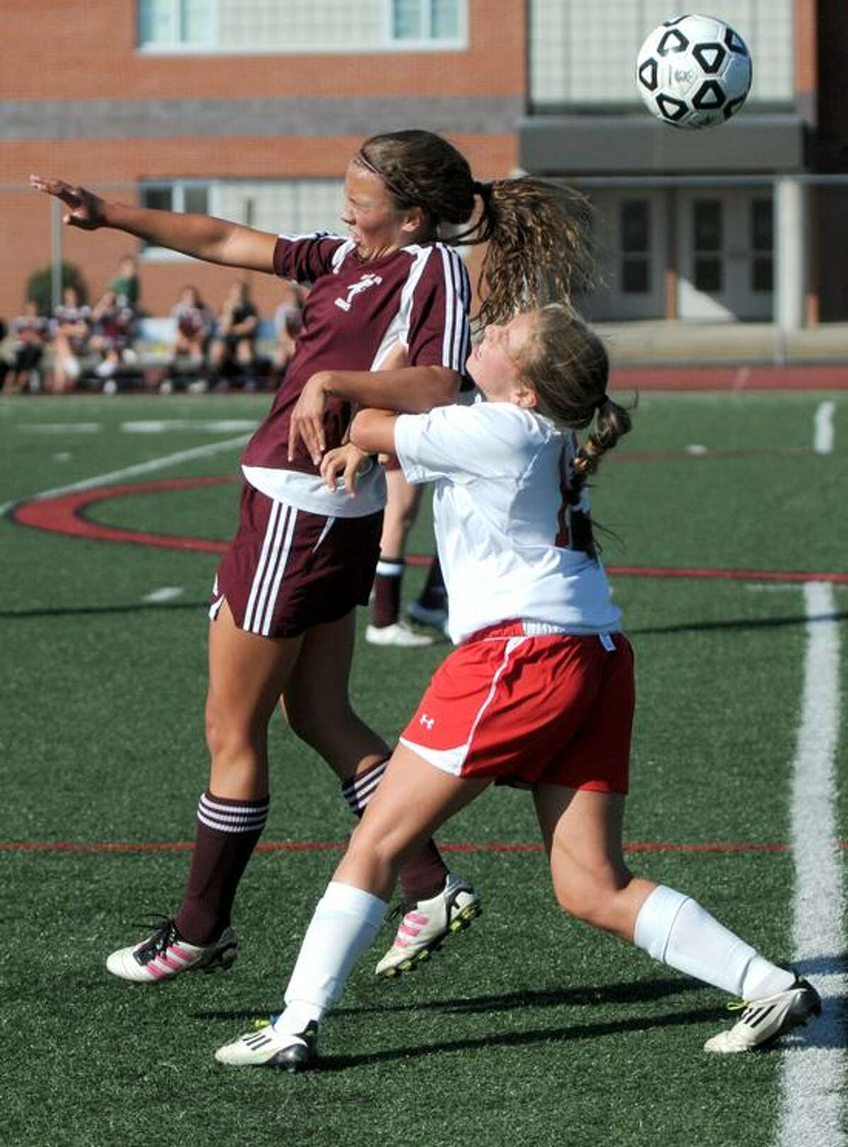 Maggie Sullivan of North Haven High School, left, and Hannah Milles of Branford High School battle for the ball during first half soccer action at Branford. Tuesday September 25, 2012. Photo by Peter Hvizdak / New Haven Register