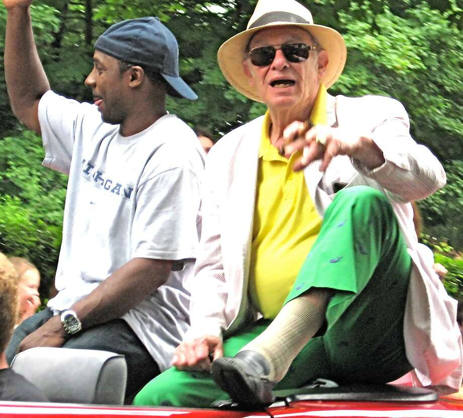 Dispatch Photo by KURT WANFRIED Hall of Fame boxing writer Bert Sugar, right, rides in the 2011 Parade of Champions in Canastota with Desmond Howard, the 1991 Heisman Trophy winner and Most Valuable Player of Super Bowl XXXI.