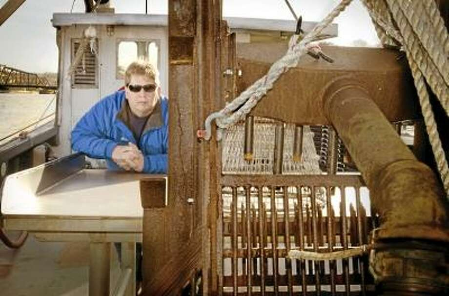 New Haven___Fisherman, Mike Franza on the deck of his boat ,Rock and Roll. Melanie Stengel/Register