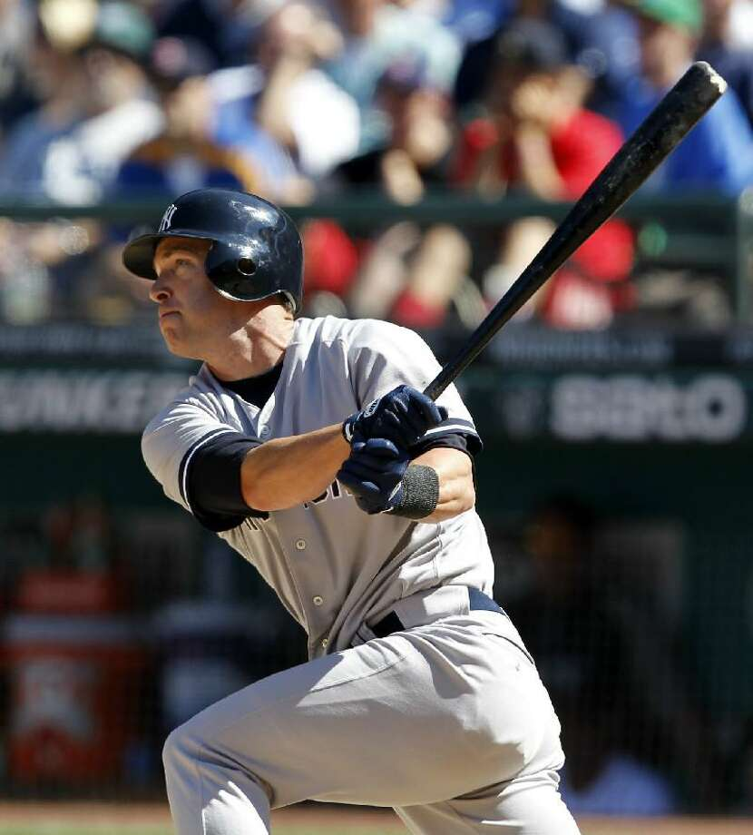 ASSOCIATED PRESS New York Yankees pinch hitter Jayson Nix watches the path of his three-run double against the Seattle Mariners in the eighth inning of Wednesday's game in Seattle. The Yankees won 5-2.