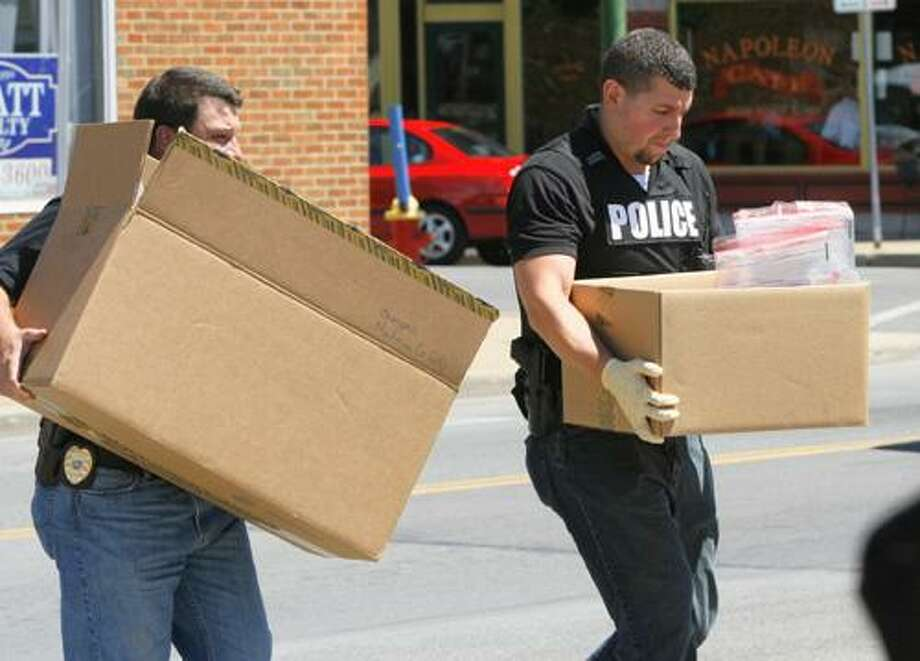 """Dispatch Staff Photo by JOHN HAEGER <a href=""""http://twitter.com/oneidaphoto"""">twitter.com/oneidaphoto</a> DEA agents with the help of the Oneida City Police remove items seized from Tebb's Head Shop  on Main  Street in the city of Oneida Wednesday, July 25, 2012 following a mid day raid."""