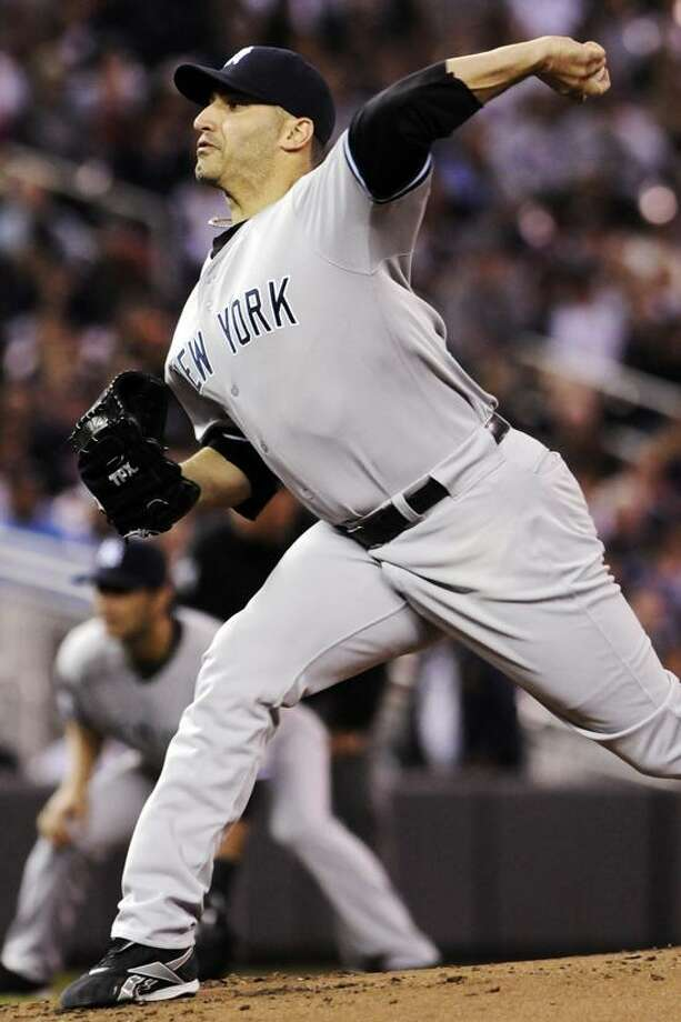 New York Yankees pitcher Andy Pettitte throws against the Minnesota Twins in the first inning of a baseball game, Monday, Sept. 24, 2012, in Minneapolis. (AP Photo/Jim Mone) Photo: AP / AP