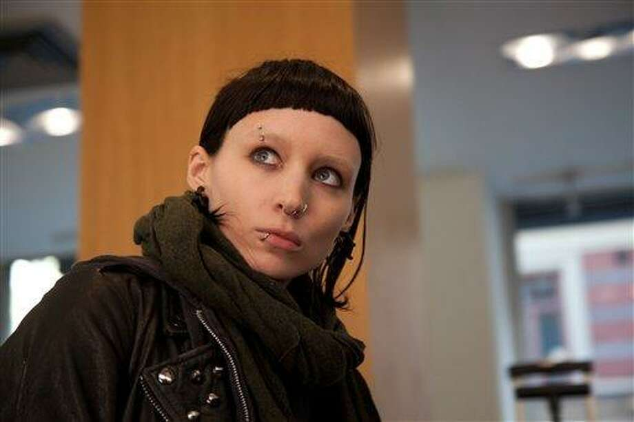 """In this film image released by Sony Pictures, Rooney Mara is shown in a scene from """"The Girl With The Dragon Tattoo."""" Mara was nominated Tuesday, Jan. 24, 2012 for an Academy Award for best actress for her role in the film. The Oscars will be presented Feb. 26 at the Kodak Theatre in Los Angeles, hosted by Billy Crystal and broadcast live on ABC. (AP Photo/Sony, Columbia Pictures, Merrick Morton) Photo: ASSOCIATED PRESS / AP2011"""