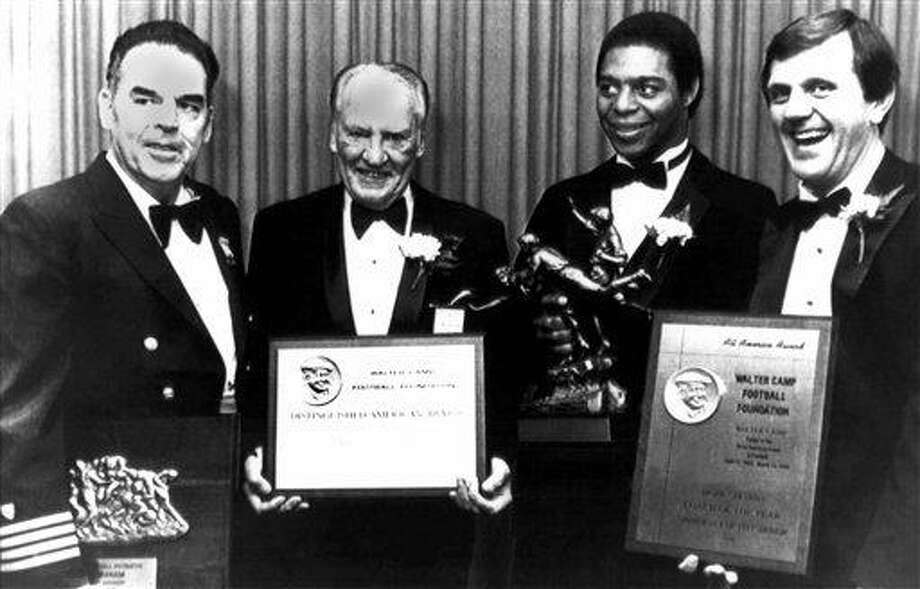 """The award recipients for the Walter Camp Football Foundation are shown with their awards before the start of the annual dinner in New Haven, Connecticut on Feb. 6, 1982. From left are: Otto Graham, Man of the Year, of the U.S. Coast Guard Academy; Harold """"Red"""" Grange distinguished American of the Year; Marcus Allen, Walter Camp Player of the Year of USC; Jackie Sherrill, Coach of the Year, former head football coach at Pitt and now athletic director and coach at Texas A&M. (AP Photo/Bob Child) Photo: AP / 1982 AP"""