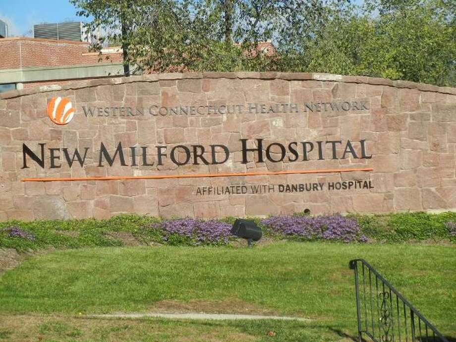 New Milford Hospital's parent company is laying off 28 employees.