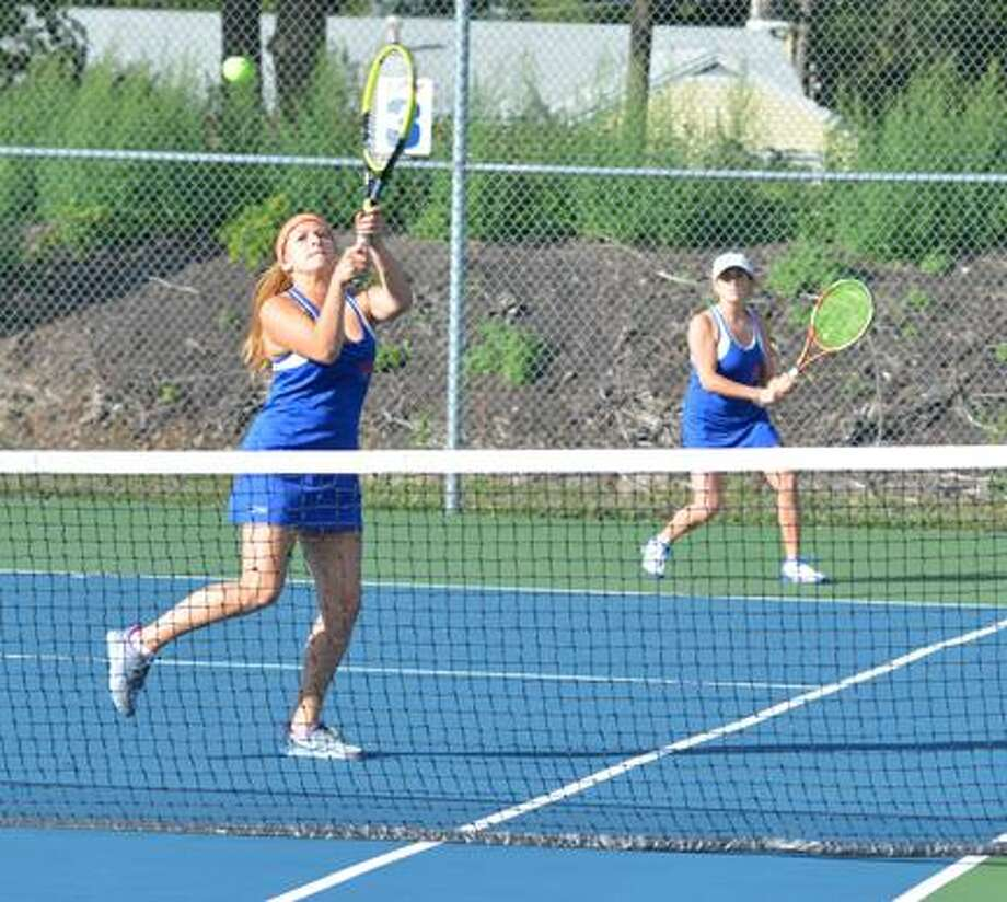 Dispatch Staff Photo by KYLE MENNIG Oneida's Anthi Docous returns a shot while Connie Froass backs her up during a first doubles match against New Hartford Monday. Docous and Froass earned a point in Oneida's 5-2 victory.