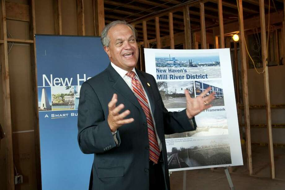 Mayor John DeStefano Jr. talks about the Mill River District development plans. He's at a press conference  held the former power plant on Grand Avenue.   Melanie Stengel/Register
