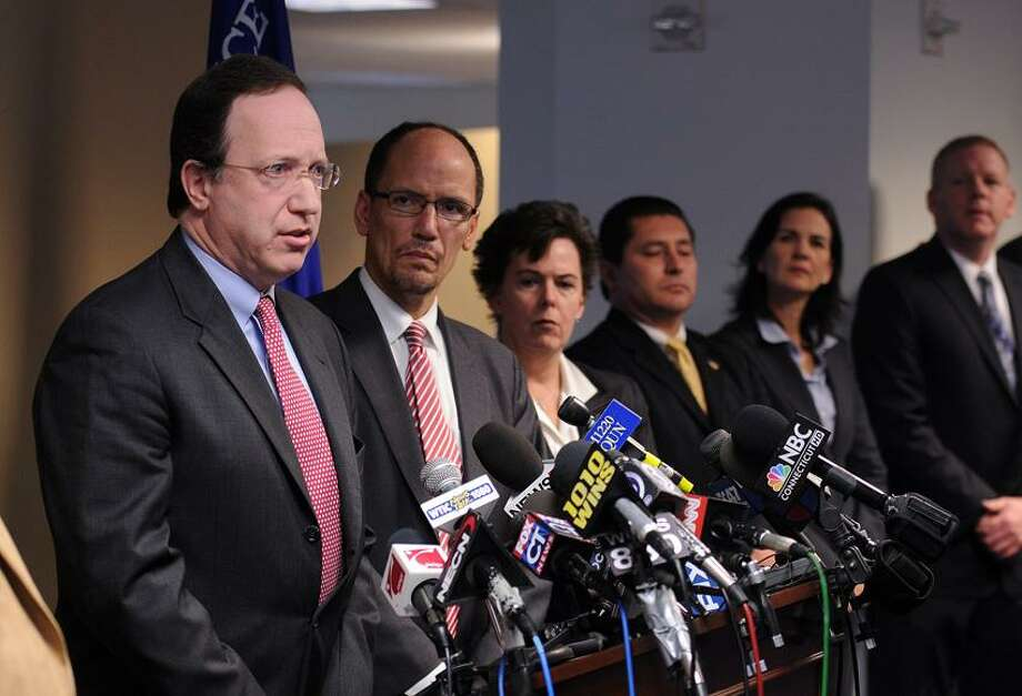 From left to right, David B. Fein, U.S. Attorney for the District of Connecticut; Thomas E. Perez, Assistant Attorney General in charge of the Civil Rights division; and Janice K. Fedarcyk, Assistant Director in charge of the New York office of the FBI  announced the arrests of four East Haven police officers after an investigation into civil rights abuses by the accused officers. The press conference was held at the U.S. Attorney's Office in Bridgeport. Peter Casolino/Register
