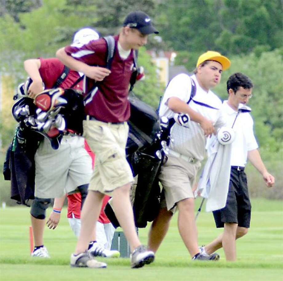 Dispatch Staff Photo by DAVID M. JOHNSONStockbridge Valley's Brandon Pupp, left, and Canastota's Ian Campbell walk off the 16th tee after their drives during the first round of the state tournament qualifier, Thursday, May 24, 2012.