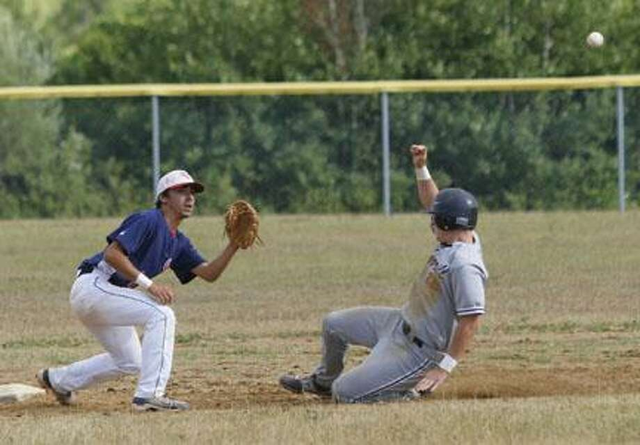 Dispatch Staff Photo by JOHN HAEGER (Twitter.com/OneidaPhoto)Sherrill's Alex Saville (22) slides into second on a steal attempt as Clonan's RJ Spinella (1) awaits the throw in the bootom of the third inning on Tuesday, July 24, 2012 in Verona.