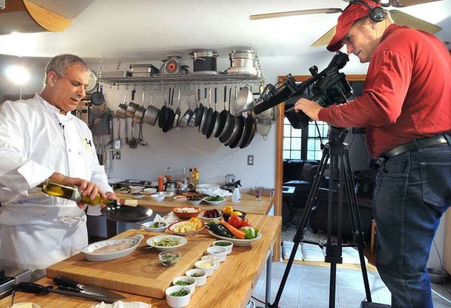 Jeff Trombetta, adjunct professor at UNH, makes cooking videos for the website eHow. They are filmed at his Guilford home by Alan Mack of Spinning Horse Video Productions. Mara Lavitt/New Haven Register