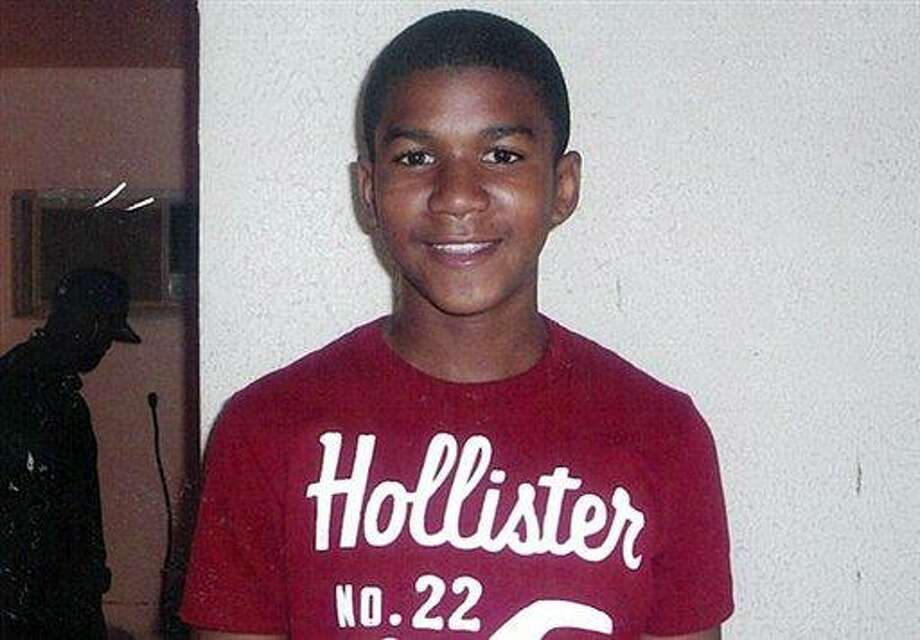FILE - This undated file family photo shows Trayvon Martin. Martin was slain in the town of Sanford, Fla., on Feb. 26 in a shooting that has set off a nationwide furor over race and justice. Neighborhood crime-watch captain George Zimmerman claimed self-defense and has not been arrested, though state and federal authorities are still investigating. Since the slaying, a portrait has emerged of Martin as a laid-back young man who loved sports, was extremely close to his father, liked to crack jokes with friends and, according to a lawyer for his family, had never been in trouble with the law. (AP Photo/Martin Family, File) Photo: ASSOCIATED PRESS / AP2012