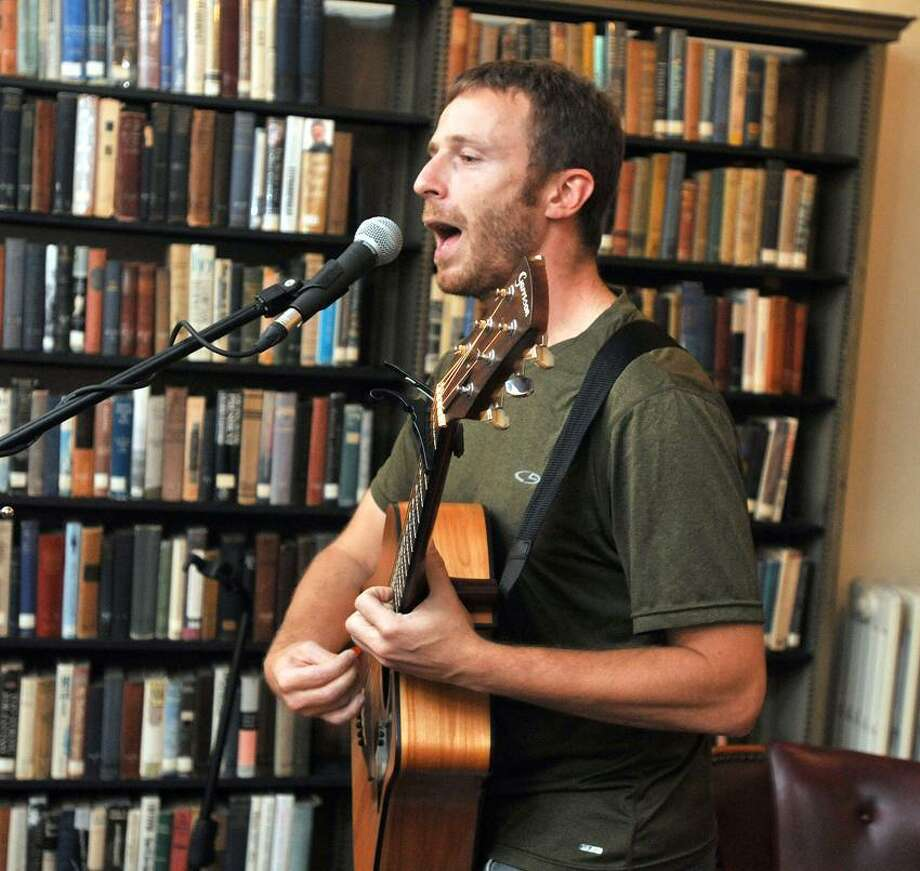 """Peter Rothbart of """"Found"""" magazine, plays a song inspired by a found note at the Institute Library in New Haven during a talk there. Photo Peter Casolino/New Haven Register"""