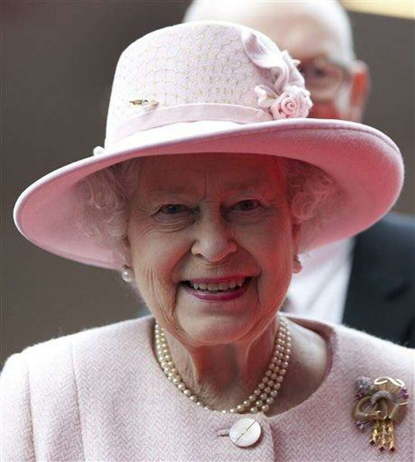 Britain's Queen Elizabeth II smiles during her visit to the Manchester Central convention centre, Manchester, England, Friday, March 23, 2012. (AP Photo/Jon Super, Pool) Photo: AP / AP POOL