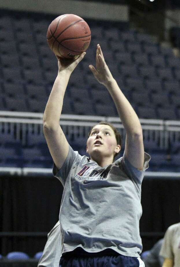ASSOCIATED PRESS Connecticut center Stefanie Dolson shoots a ball during practice in Kingston, R.I., Saturday. Connecticut plays Penn State in an NCAA women's tournament regional semifinal Sunday.