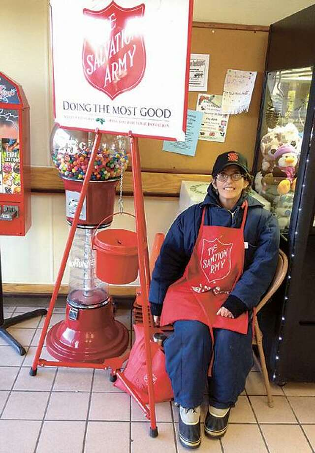 """Dispatch Staff Photo by JOHN HAEGER <a href=""""http://twitter.com/oneidaphoto"""">twitter.com/oneidaphoto</a> Anna Lamb mans the Salvation Army red kettle at Tops    on  Wednesday, Nov. 21,2012 in Canastota."""