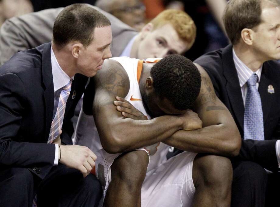 Syracuse guard Dion Waiters sits with assistant coach Gerry McNamara, left, as time winds down during the second half of the East Regional final game against Ohio State in the NCAA men's college basketball tournament, Saturday, March 24, 2012, in Boston. Ohio State won 77-70. (AP Photo/Michael Dwyer) Photo: ASSOCIATED PRESS / AP2012