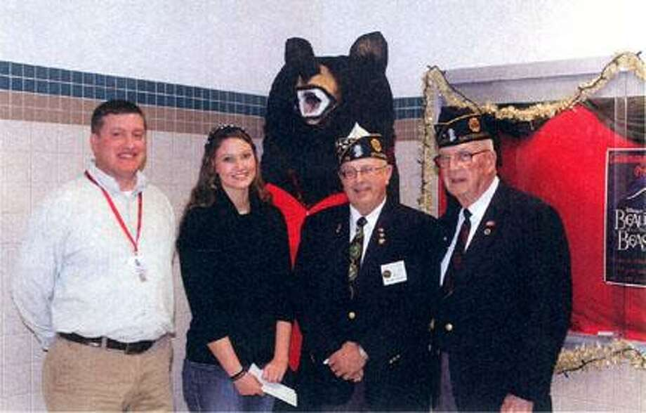 Submitted Photo Shown presenting checks are from left Justin Sylstra, adviser; Karlene Becker; Joseph Barilla, Madison County commander; and James Button, Post 1287 committee chairperson.