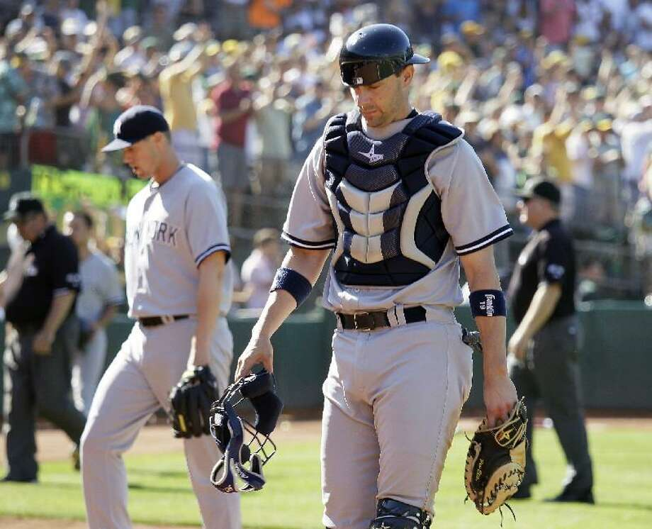 ASSOCIATED PRESS New York Yankees catcher Chris Stewart walks off the field at the end of their baseball game against the Oakland Athletics Sunday in Oakland, Calif. Oakland won the game 5-4 to sweep their four-game series.