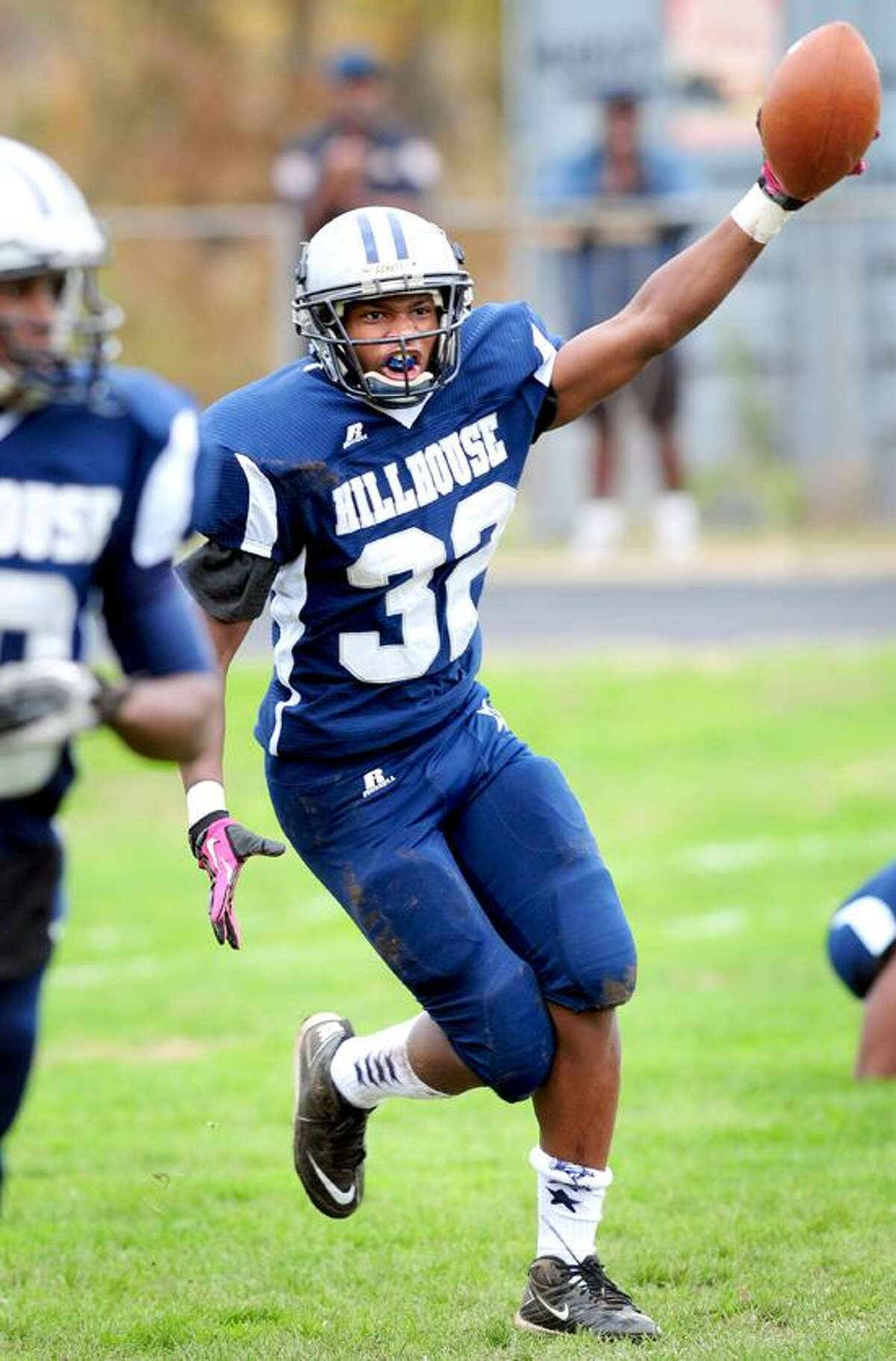 Hillhouse's William Barnes, pictured here celebrating after recovering a blocked punt for a touchdown against Xavier during the regular season, hopes to lead the Academics over Wilbur Cross and a berth in the Class M state playoffs. Photo by Arnold Gold/New Haven Register