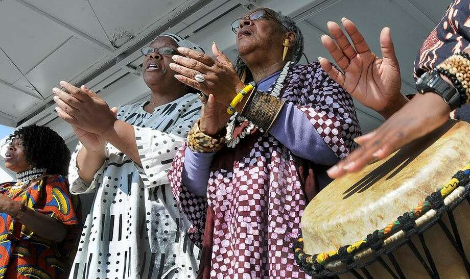 The Nzinga's Daughters, a performance group from Plainville, using music of the African Diaspora to educate and entertain. Here, they sing during an Emancipation Proclamation Commemoration at the Long Wharf Pier in New Haven Thursday,celebrating the anniversary of President Abraham Lincoln's Emancipation Proclamation, which freed those enslaved by the secessionist states before and during the Civil War. From left are Dayna Snell, Alison Johnson, Gail Williams and Joanne James.  Peter Hvizdak/Register Photo: New Haven Register / ©Peter Hvizdak /  New Haven Register