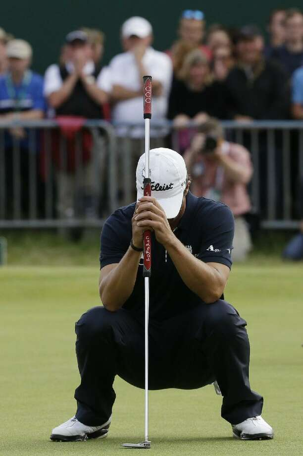 ASSOCIATED PRESS Adam Scott of Australia reacts after missing a putt on the 18th green during the British Open Golf Championship at Royal Lytham & St Annes golf club, Lytham St Annes, England, on Sunday. Scott blew a four-shot lead with four shots to play and lost out on a chance for his first Major title.