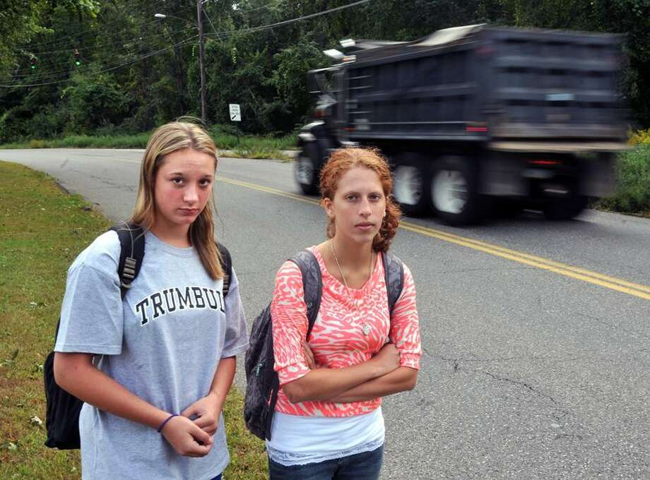 Milford--Gabrielle DiPasquale, 14, left, and Sophia Tramuta, 16, who attend the Trumbull High Agriscience and Biotech school, need to walk a two mile route to their bus stop along Wheelers Farm Road in Milford. Photo Peter Casolino/New Haven Register 09/20/2012