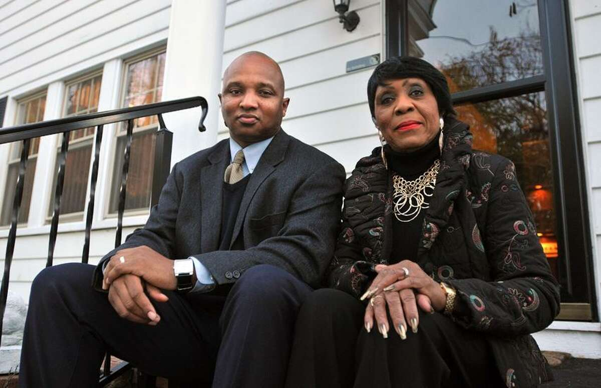 Carroll Brown, president of the West Haven Black Coalition sits with the Rev. Dr. Alexander Hamilton on her porch. Hamilton was visiting Brown for a dinner two weeks ago on a Sunday after church and was lost looking for her house. The police were called by a neighbor and Brown is looking for answers why the police were called alleging that race was a factor. Peter Casolino/New Haven Register