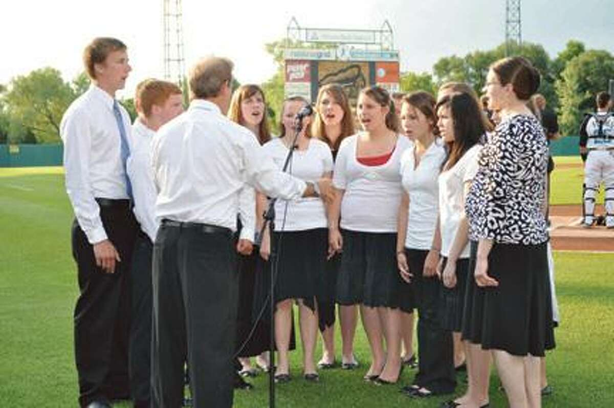 Photo Courtesy Holy Cross Academy Holy Cross Academy Select Choir students perform the National Anthem at Alliance Bank Stadium last June. They have been chosen to sing the National Anthem prior to the Baltimore Orioles home game against the Kansas City Royals on Friday, May 25.