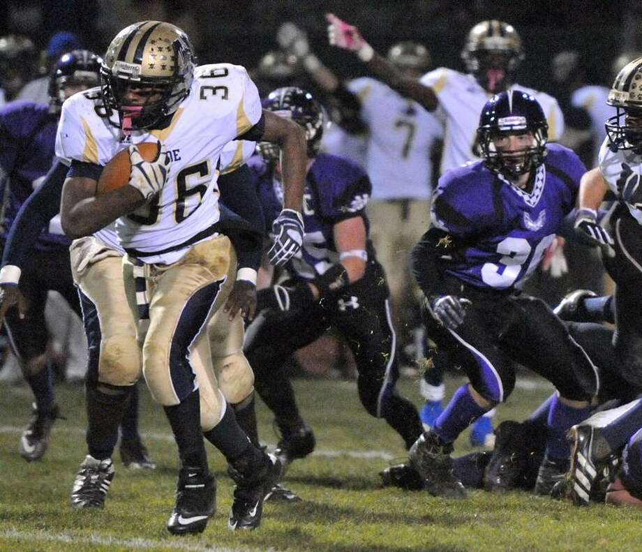 Hyde's Akeem Berry is on his way to a first-quarter touchdown. North Branford came from behind to beat Hyde 32-28. Peter Casolino/New Haven Register.